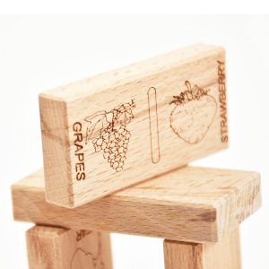 Beech tree wood dominoes with engraved pictures of fruits