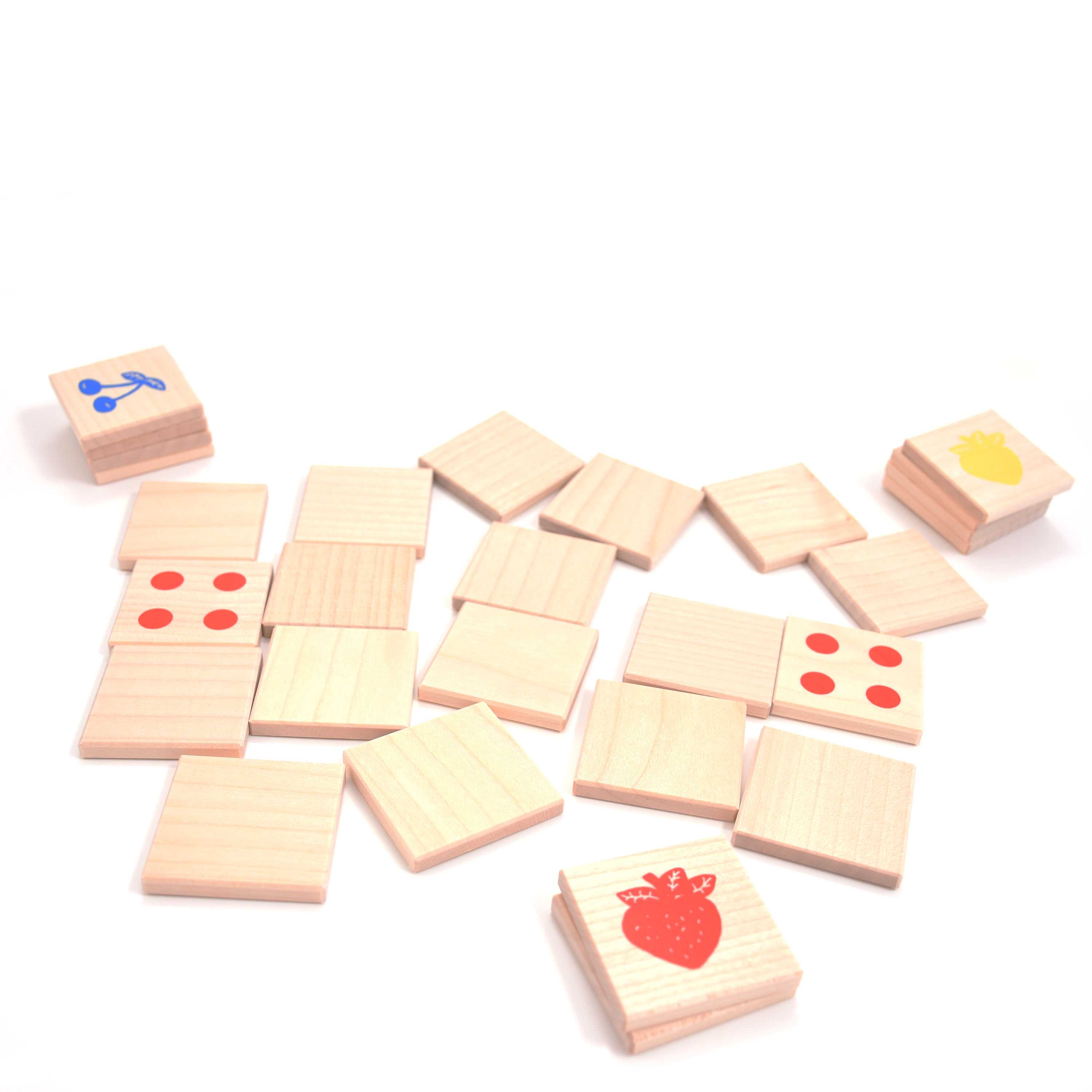 Maple tree wood memory game with yellow, red and blue pictures of fruits