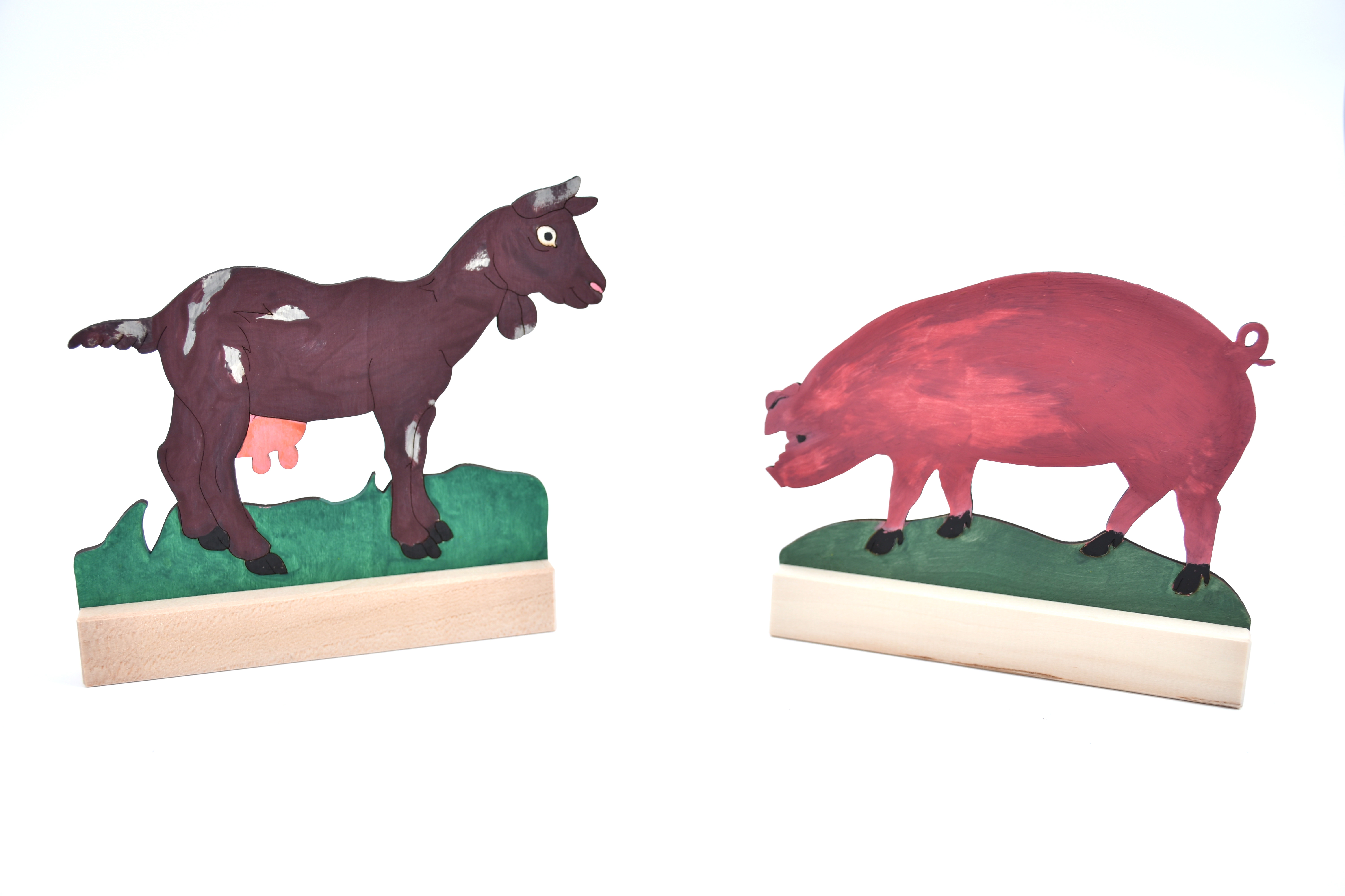 Goat and pig figure coloured